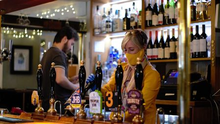 Daisy Cooper MP serving drinks in The White Lion after pubs reopened last year.