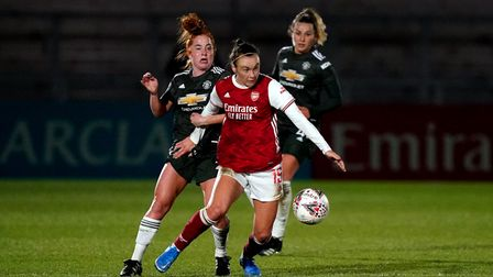 Manchester United's Martha Harris (left) and Arsenal's Caitlin Foord battle for the ball during the