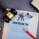 Smith & Pinching Inheritance Tax (IHT) paperwork on a desk