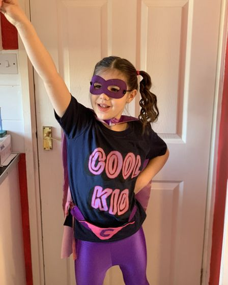 Caicha, 8, dressed up as a superhero for school on Red Nose Day