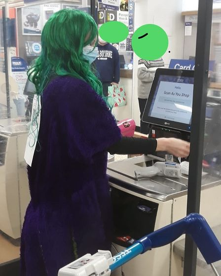 Louise stayed in her costumes all day - even at the supermarket.