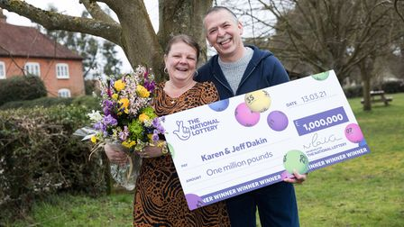 Jeff and Karen with a national lottery card