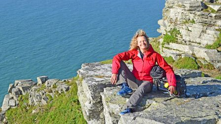 Kate Humble walks Britain's coastal paths - pictured on a clifftop on a sunny day