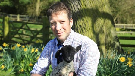 Julian Norton, The Yorkshire Vet cuddles a newborn lamb