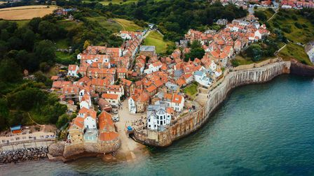 An aerial view of Robin Hood's Bay with cottages that huddle by the sea