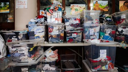 Boxes of donated clothes that have been sorted into categories are piled up, November 8, 2020