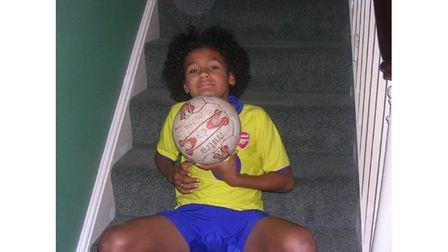 Boy footballer on stairs with ball