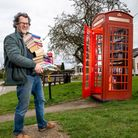 A BT phone box converted into a book exchange