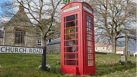 A phone box which now stores a defibrillator unit.