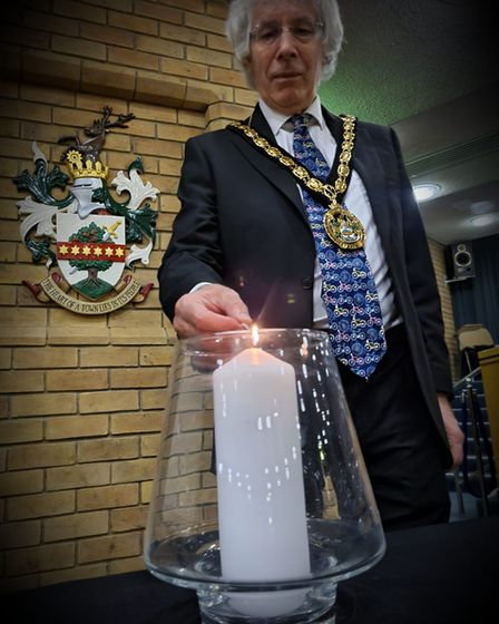 Mayor of Stevenage Cllr Jim Brown lit a candle for the day of reflection