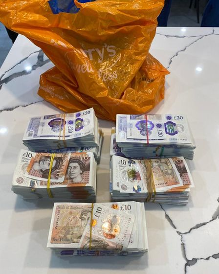 Approximately £150,000 in cash was seized as part of the raids which saw 20 addresses raided across London.