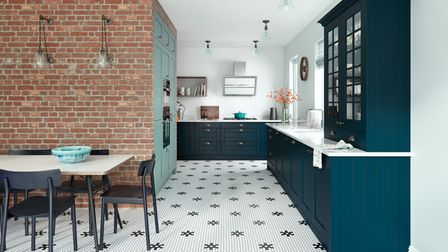 Navy kitchen with brick wall feature