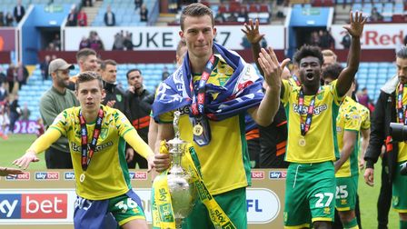 Christoph Zimmermann of Norwich with the trophy at the end of the Sky Bet Championship match at Vill