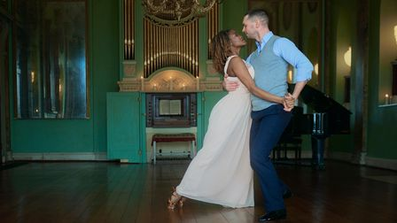 Strictly's Oti Mabuse and her dance partner Marius Iepure in the historic ballroom of Powderham Castle.