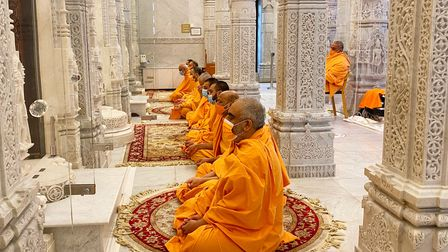 Swamis at Neasden Temple observe a minute of silence