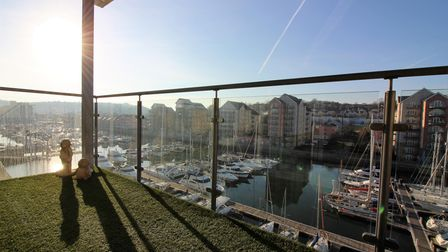 Artificially-grassed terrace with glass panels in the penthouse in Mizzen Court, overlooking Portishead Marina.