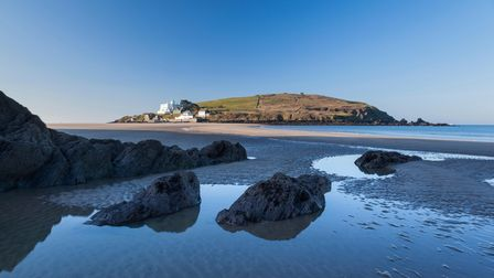 Bigbury Sands beach in Devon with Burgh Island on the horizon.