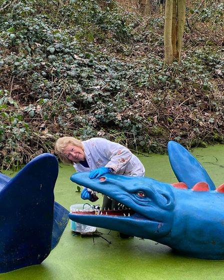 Patti doing some dentistry work on a dinosaur at Knebworth.