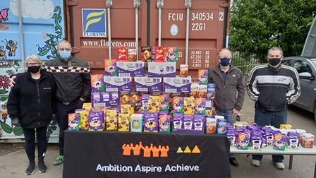 John Pryke, Barry Pryke and Chris Ruse present donated Easter eggs to Ambition Aspire Achieve'sPaula Blake.