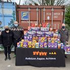 John Pryke, Barry Pryke and Chris Ruse present donated Easter eggs to Ambition Aspire Achieve's Paula Blake.