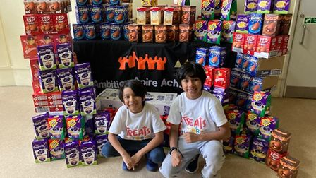Neo Jain Naha and his brother Rico with 400 Easter eggs they donated to the Newham appeal.