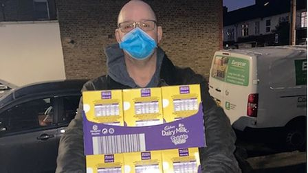 Chris Ward with boxes of chocolate to donate to the Newham Easter Egg Appeal.