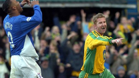 Iwan Roberts after scoring his second goal in Norwich City's 2-0 win at Ipswich