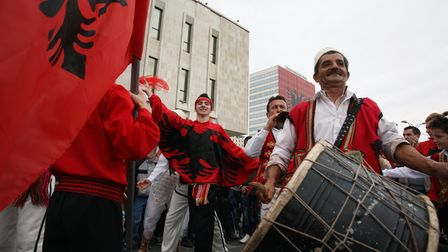 Albanians in Tiranacelebrate the 100th anniversary of independence from the Ottoman Empire in November, 2012