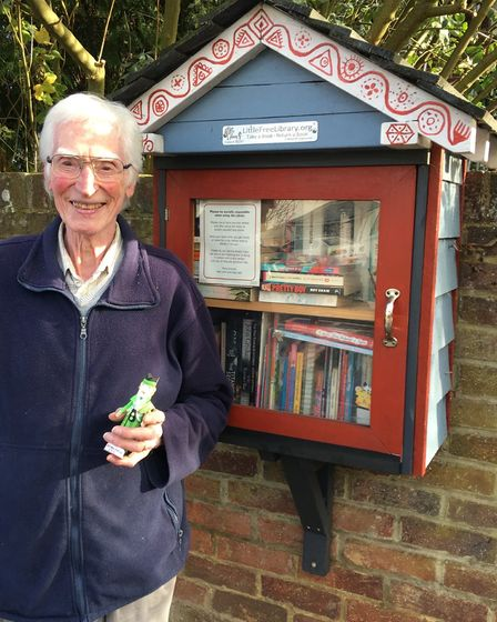 John Wheeler with paper figurine outside the Mile House Lane library, St Albans
