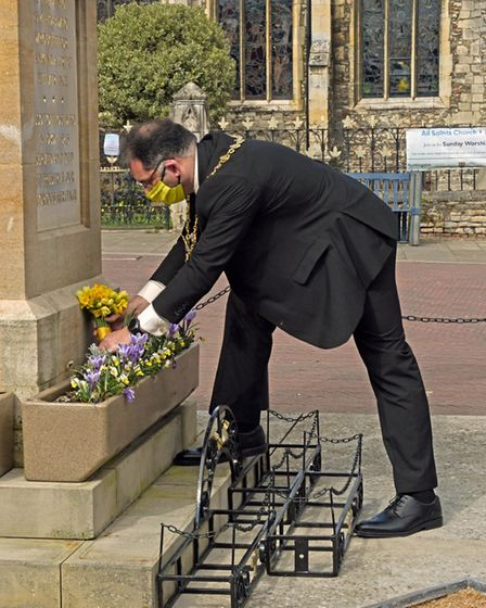 Cllr Karl Webb laying his flowers on the Market Square in Huntingdon.
