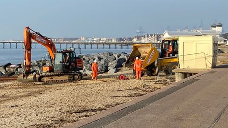 Contractors working to protect the Peter's Ice Cream kiosk in Undercliff Road West, Felixstowe