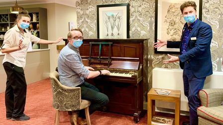 Staff at Melbourn Springs Care Home enjoying the new piano