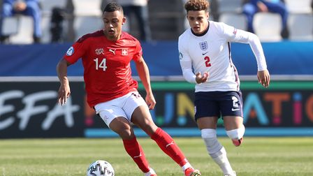 Switzerland's Dan Ndoye (left) and England's Max Aarons battle for the ball during the 2021 UEFA Eur