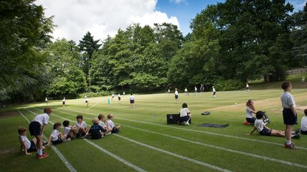 Children at Kent College relaxing on a sports field