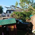 The playhouse was destroyed when a car plunged into the back garden.