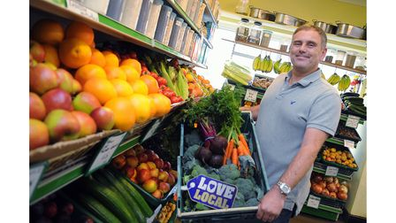 Steve Yarham of the Ford and Yarham greengrocers and fishmongers in Gloucester Street, backing the L