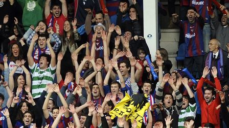 Basque flags and Celtic shirts can be seen as Eibar's fans celebrate during the team's promotion campaign in 2014