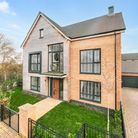 St Modwen Olive-design three-storey home in Locking Parklands, Weston with half-timber front and floor-to-ceiling windows