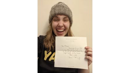 Hannah Beaumont with her letter from Sir David Attenborough