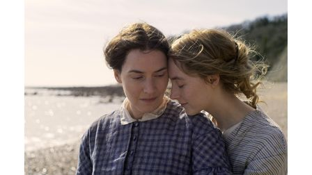 Kate Winslet as Mary Anning and Saoirse Ronan asCharlotte Murchison in the film Ammonite
