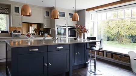 Open plan kitchen with floor to ceiling window overlooking the garden at Magdalena Atkins' home in Letty Green, Herts