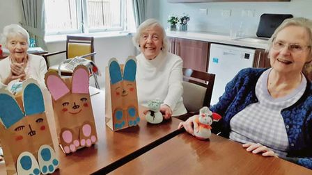 Ferrars Hall residents with their Easter Bunny crafts.
