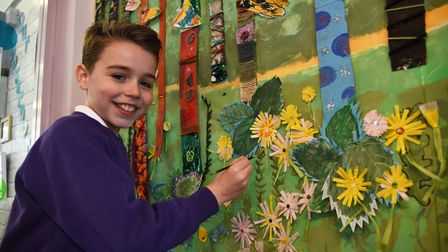 """Harry with the painting inspired byDavid Hockney's """"The Arrival of Spring"""" at Dale Hall Primary School"""