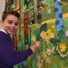 "Harry with the painting inspired by David Hockney's ""The Arrival of Spring"" at Dale Hall Primary School"