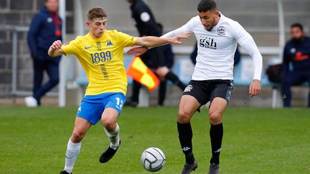 Adam Randell of Torquay United challenges for the ball with Bilel Hinchiri of Dover Athletic during