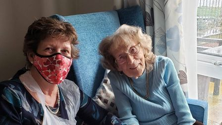 Sheila Coleman,who lives at Cavell Court inCringleford,with herdaughter,Jackie, who is wearing a mask
