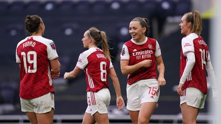 Arsenal's Katie McCabe celebrates scoring their third goal against Tottenham