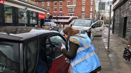 Brent's clean air officers in Kilburn High Road warning motorists of idling fines. Picture: Brent Co