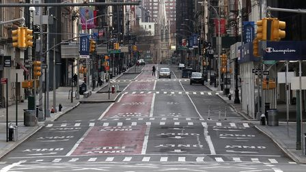 A virtually empty Broadway in New York City on Easter Sunday. Photo by Gary Hershorn/Getty Images