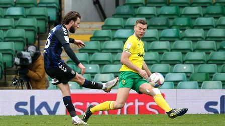 Ben Gibson of Norwich tries to block a shot from Jonathan Howson of Middlesbrough during the Sky Bet